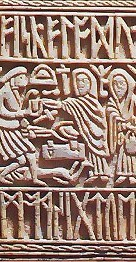 Detail on the Franks Casket showing the mythical figure Weyland the Smith and some runes