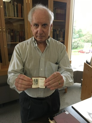 ENGL WRIT 2223 Librarian Peter Glenister displaying miniature Shakespeare