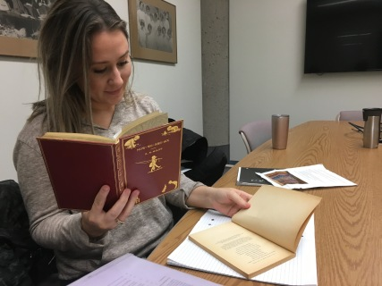 ENGL WRIT 2223 student Nicole Leggat doing research in the MacDonald Collection